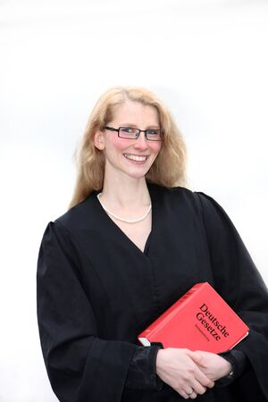A young lawyer is smiling and holding a law book in hand Stock Photo - 8315010