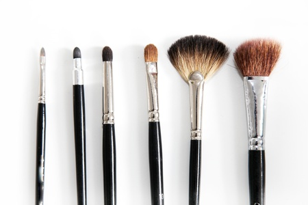 various brushes for makeup in a row on a white background Stock Photo - 9318350