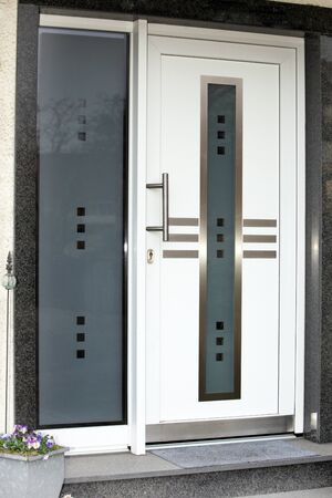 Modern front door with glass panes of the page
