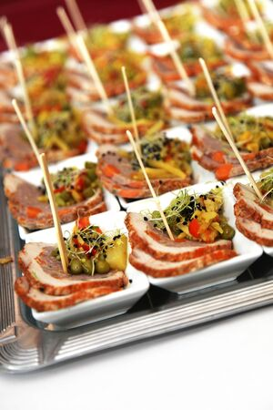 restaurant - finger food - meat in small bowls Stock Photo