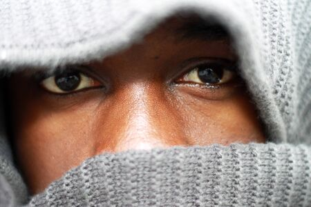 eyes hidden: Young African American-masked only the eyes can see, close-up Stock Photo