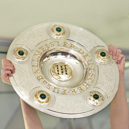 The award for the championship trophy as German football champions is held high - square