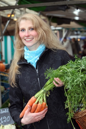 Woman on the market with vegetables