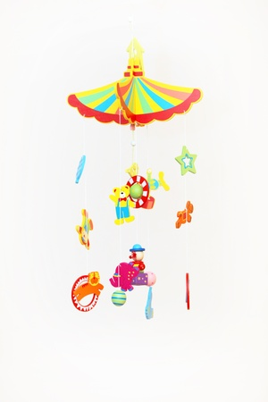 Colourful Hanging Toy Mobile with many suspended delicate shapes to be set in motion by air currents or by hand Stock Photo - 12442433