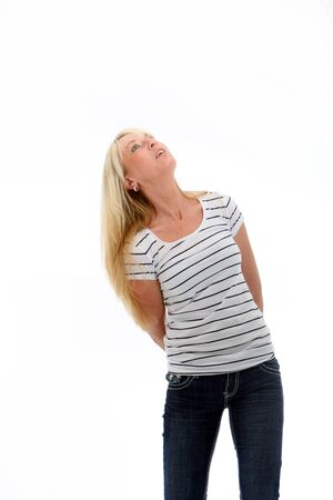 tilted: Pretty blonde woman in close fitting top looking up Stock Photo