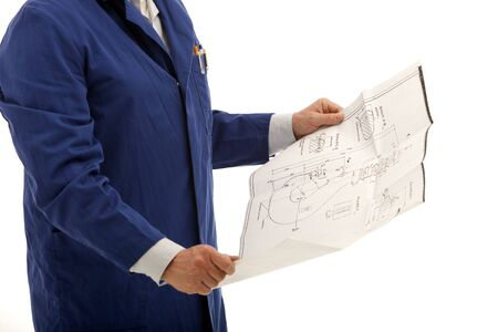 Hands of an engineer or contractor consulting a blueprint drawing isolated on white Stock Photo - 12891432