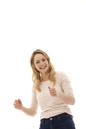 low spirited: Young enthusiastic blonde woman with her fists clenched in jubilation and a broad smile