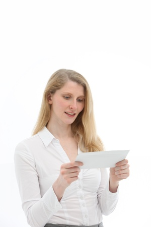 interested: Attractive blonde woman with attentive expression reading a thought-provoking letter Stock Photo