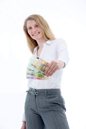 brandishing: Low angle shot of a smiling successful woman brandishing a fistful of fanned euro notes of different denominations