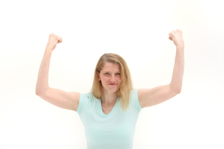 angry blonde: Woman shaking her raised fists in the air in frustration isolated on white Stock Photo