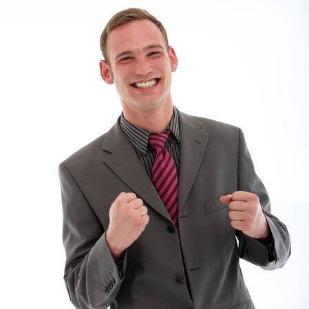 jubilation: Excited businessman punching his fists in the air in jubilation at the news of his success or promotion