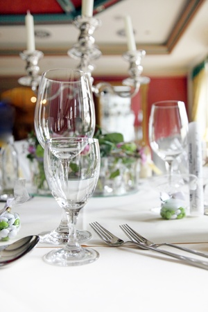 formal place setting: Elegant formal place setting with wine glasses and silver cutlery and candelabra. Stock Photo