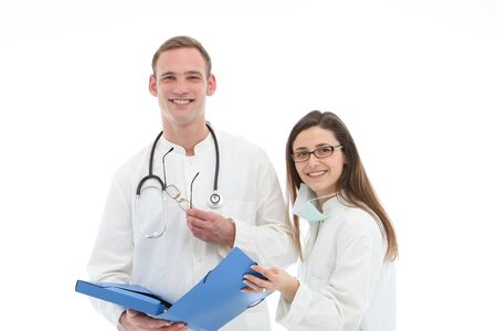 folio: Smiling young male doctor and his female assistant or nurse standing holding a blue folio discussing patient records
