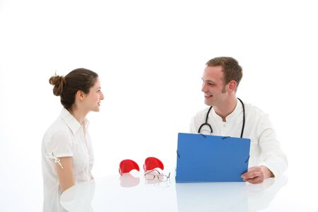 orthopaedic: Smiling doctor and his patient are sitting at the table on white background