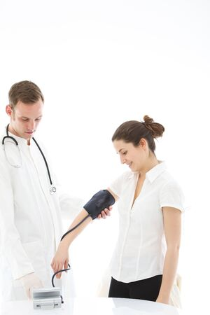 arterial: Doctor taking the blood pressure reading of a female patient using a sphygmomanometer