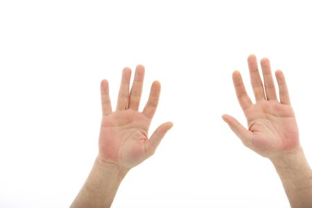 Human hands raised up isolated on white photo