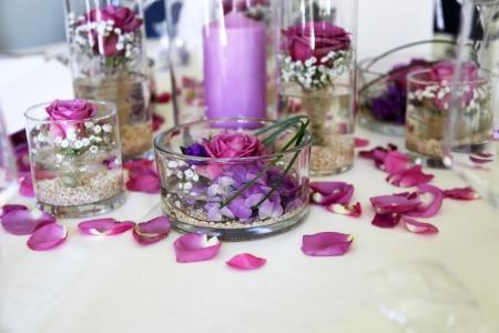 intricate flower arrangement centerpiece of purple flowers and petals