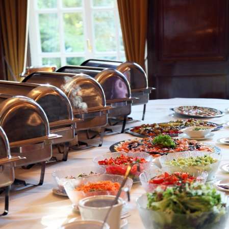 hospitality: array of dishes placed on buffet table Stock Photo