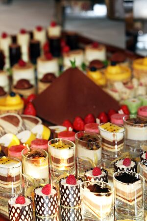 Gourmet catering for a special occasion with a buffet table filled with a selection of individual desserts Stock Photo