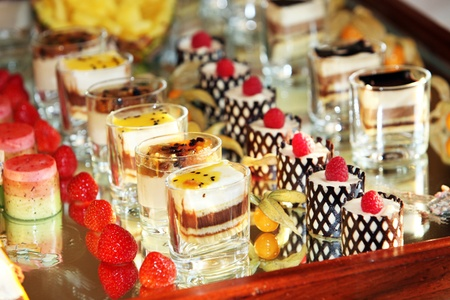 Decorative delicious dessert selection of individual portions at a luxury catered function or wedding Stock Photo