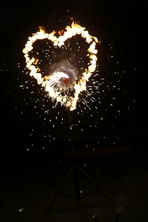 Symbolic flame heart burning brightly in the night with a fiery explosion of sparks