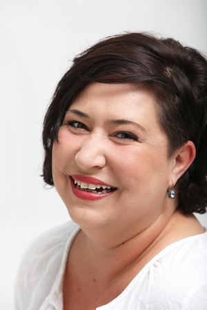 mirth: Vivacious laughing overweight woman smiling spontaneously as she enjoys life to the full Stock Photo