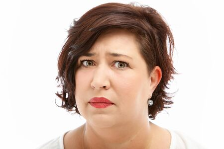 angst: Anxious worried middle-aged woman with upset expression isolated on white