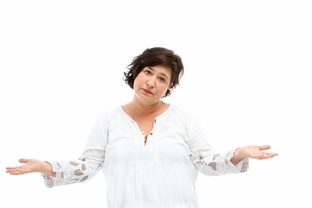 Ignorant woman shrugging her shoulders and extending her arms to indicate she has no clue or a possible conceptual image for product placement in her empty palms Stock Photo - 18815007