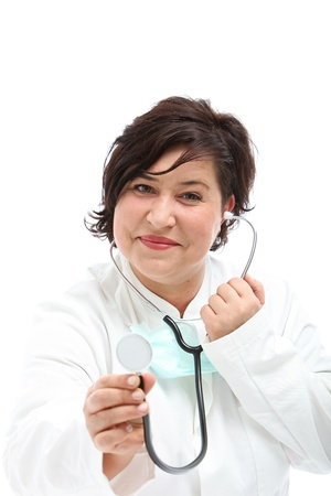 heart sounds: Doctor approaching with a stethoscope disc held at the ready so that she can listen to and monitor the sounds of a patients lungs and heart Stock Photo