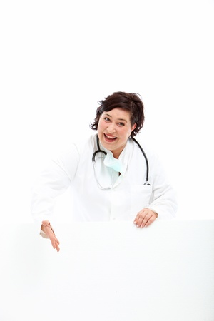 endorsement: Smiling vivacious doctor indicating a blank white board with her hand as she gives her endorsement to your advertisement or announcement