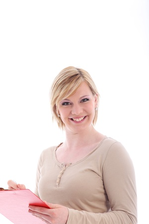 pert: Pert attractive young lady with a lovely smile filling in a form which she is holding in her hand