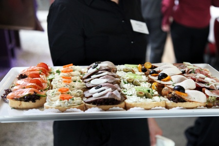 serving tray: Waiter offering a tray of delicious gourmet appetizers at a wedding reception or catered event