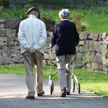 Rear view of senior couple walking outdoors photo