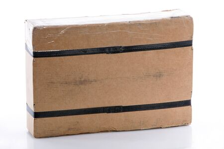 straps: Strapped rectangular cardboard box ready for mail or courier delivery of an ordered product Stock Photo