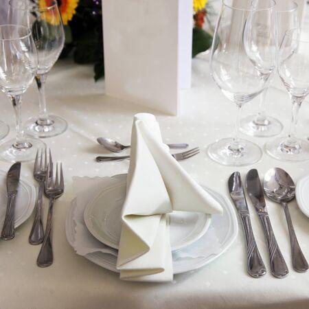 Table set for a formal dinner celebration Stock Photo