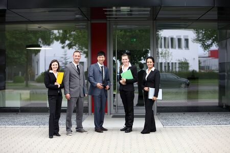 fair skin: Business colleagues standing outside the office building