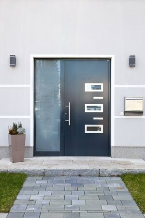 Architectural Detail Focusing on Door of Modern Home Stock Photo