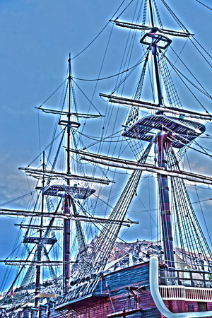 filtered: Filtered Image of Detail of Old Antique Sailing Ship with Three Masts and Rigging Against Blue Sky
