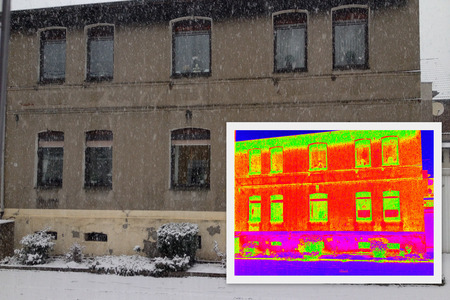 heat radiation: old House with a thermal imaging showing lack of thermal insulation Stock Photo