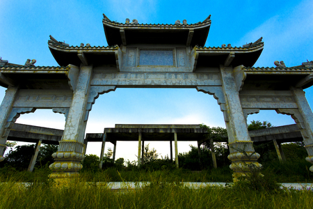 Abandon chines style gate in the forest.