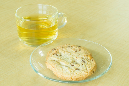 cookie and tea on desk photo