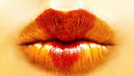 orange golden lips with red heart lipstick photo