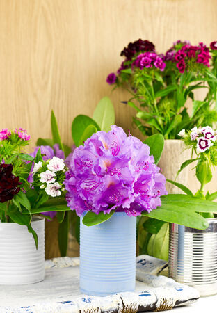 Different colorful spring flowers with handmade vases, selective focus photo
