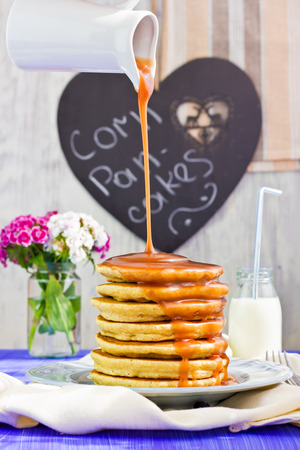 Corn pancakes with caramel sauce