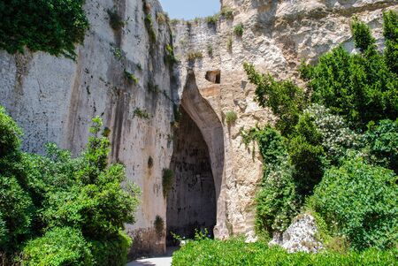 The entrance to the cave of Dionysius in archaeological park Stock Photo
