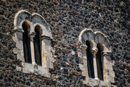 Detail of windows on the main side of the medieval castle in Paterno. Sicily
