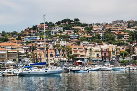 Acitrezza, Italy - June 01, 2017: A group of boats anchored in the small sicilian harbor