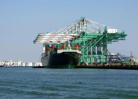 payload: Container ship being loaded Stock Photo