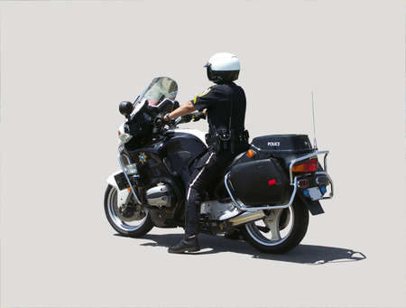 motorcycle officer: motorcycle policeman isolated on grey