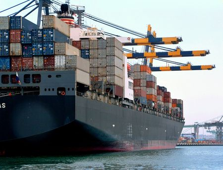 container ship along loading dock being loaded photo